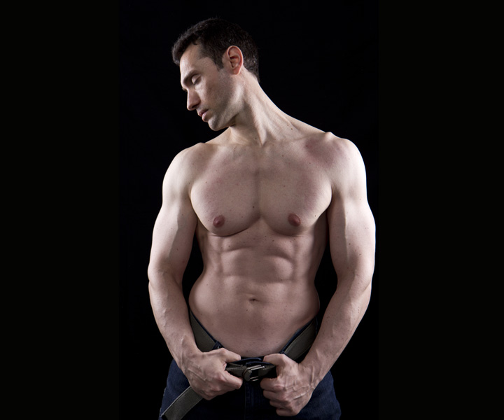 a sexy male stripper without a shirt
