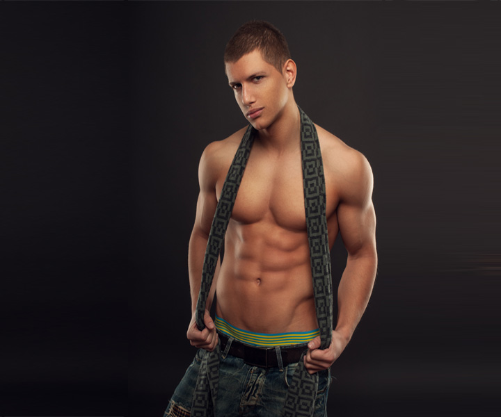 Male stripper with a scarf around his neck and no shirt